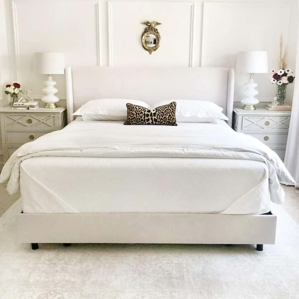 Beige and white bed with farmhouse styled side tables.