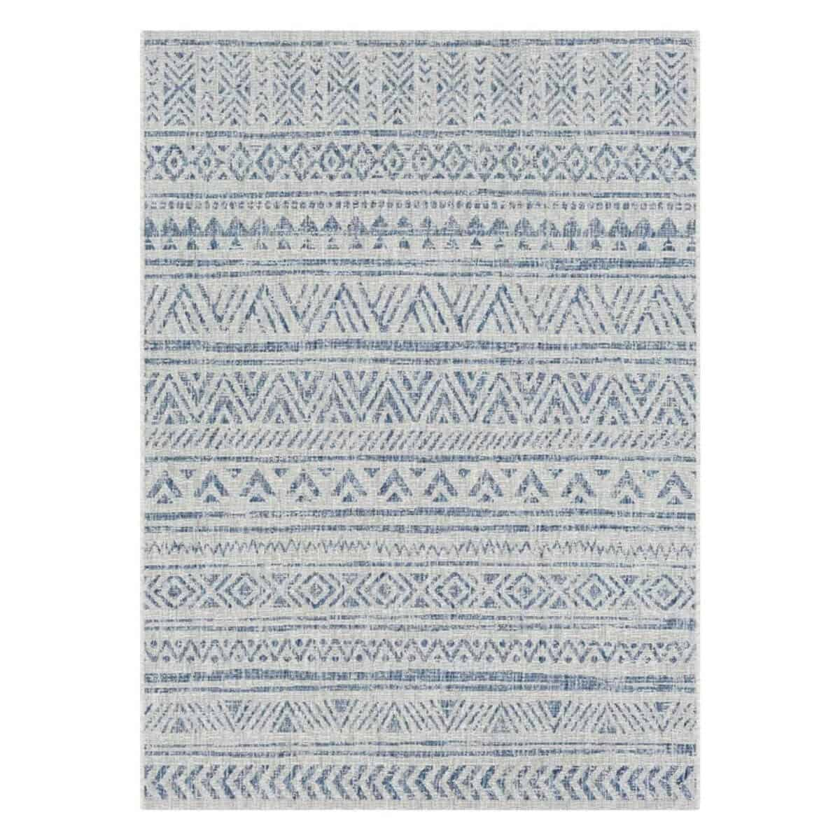 Blue and grey rug with geometric patterns.