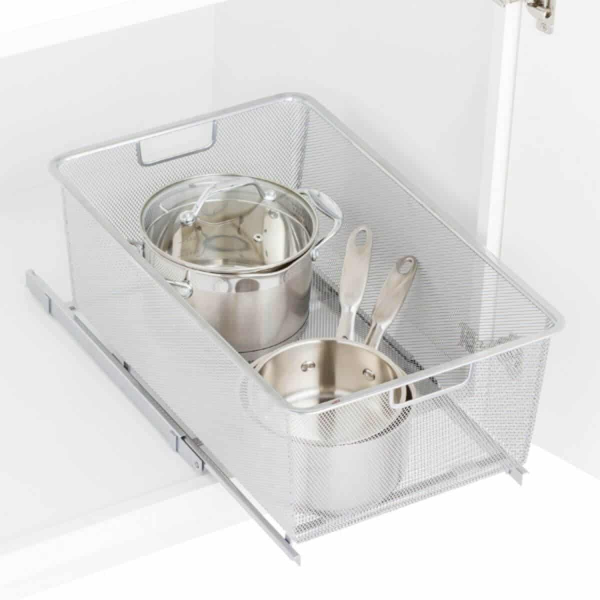 Mesh pull-out drawer with pots in it.