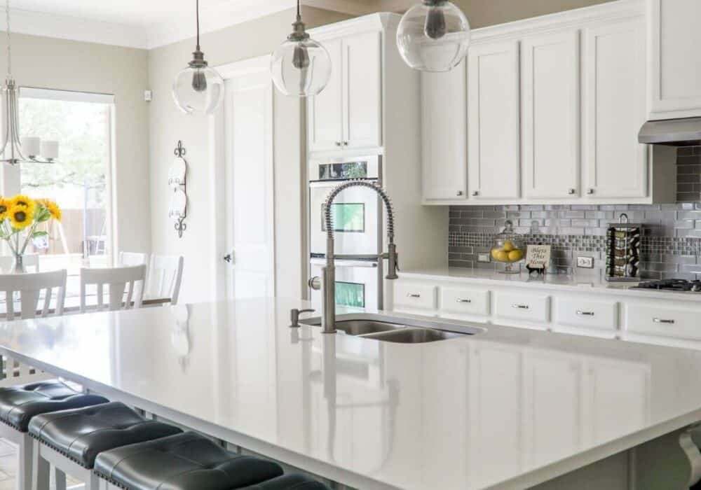 White kitchen with an island.