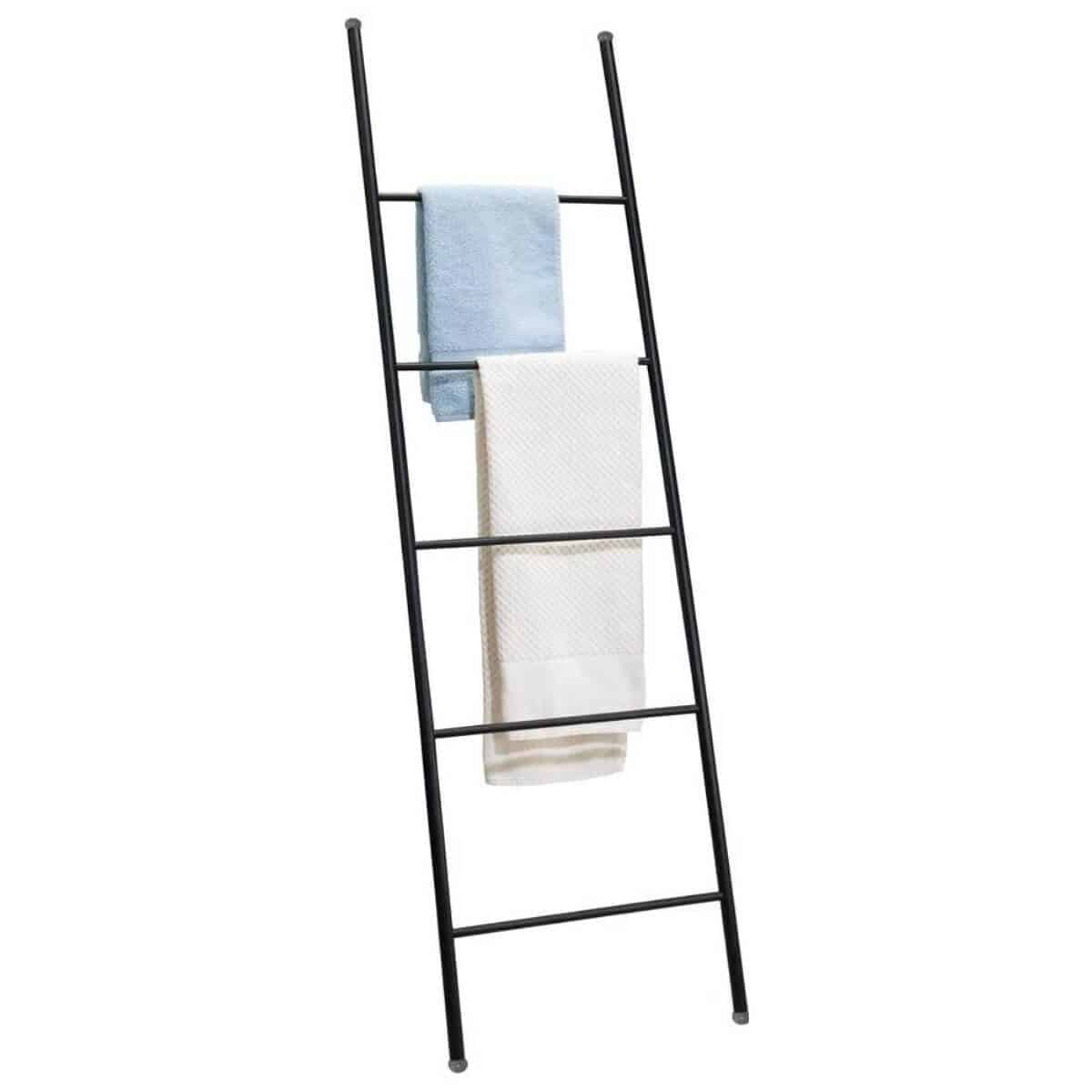 Black towel ladder with two towels on it.