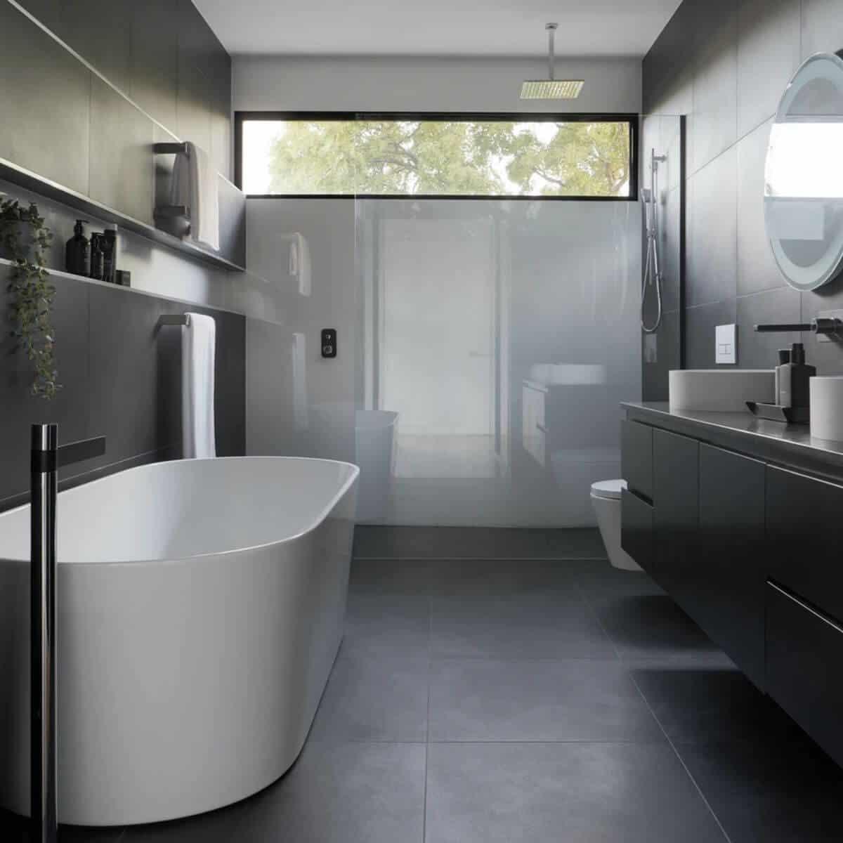 Dark ceramic modern bathroom with a soaking tub.