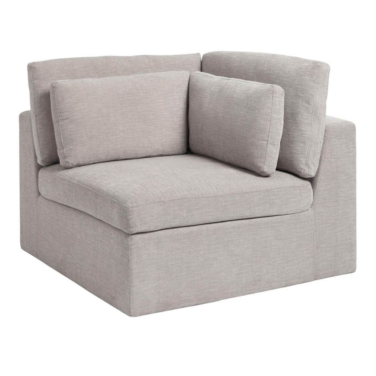 Grey fabric corner chair with pillows.