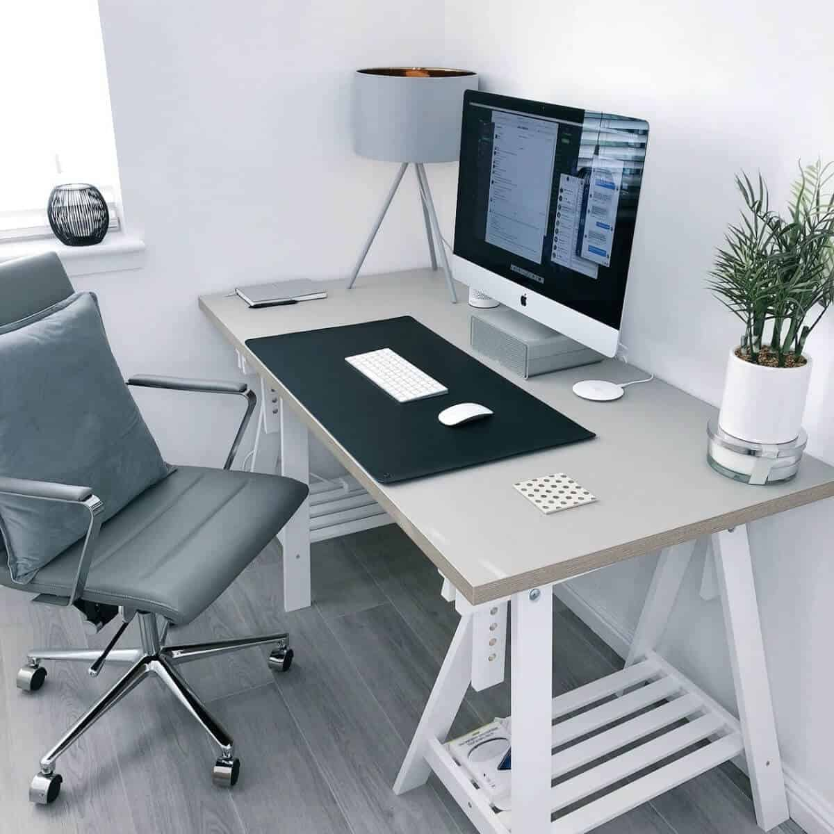 Home office desk and chair in a room.