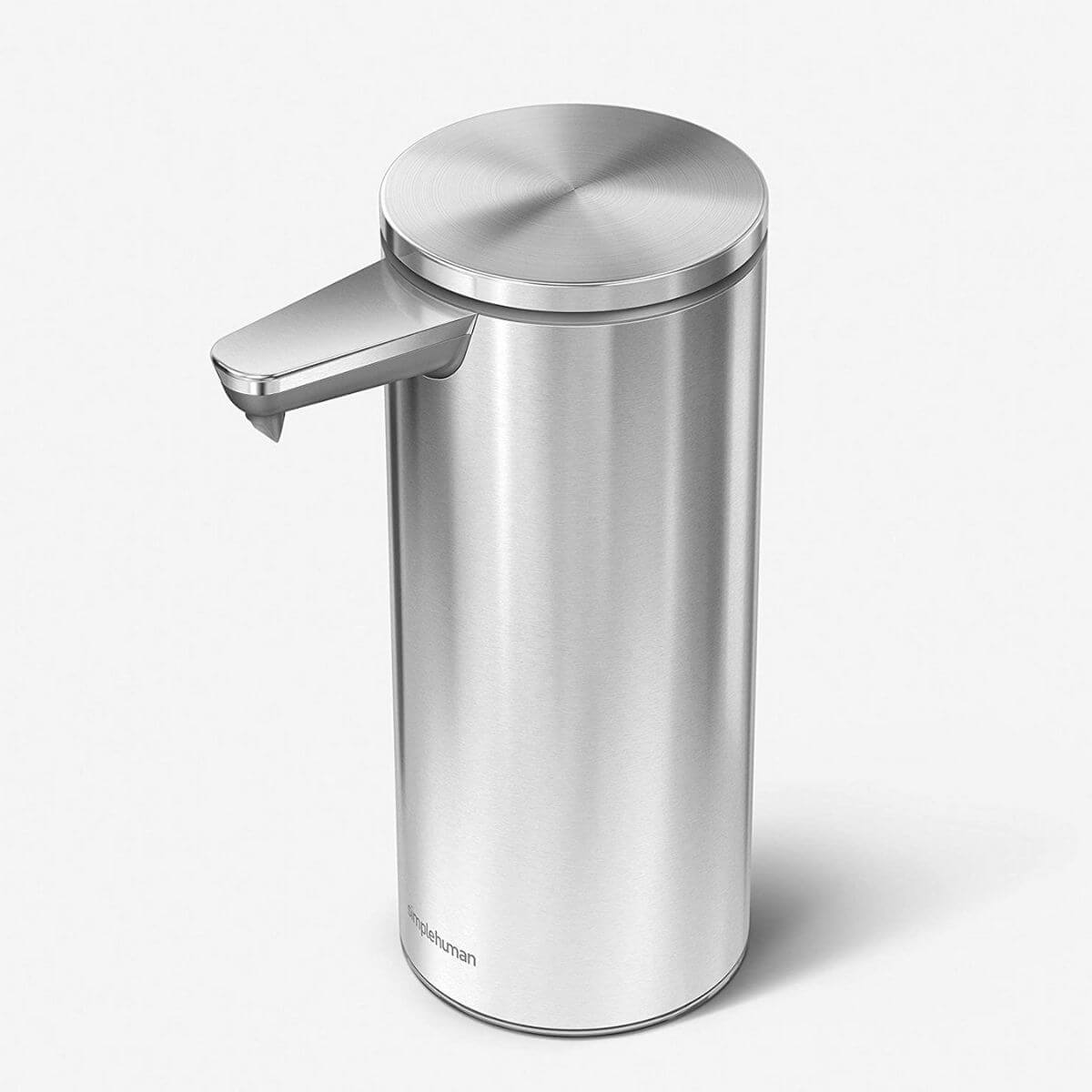 Brushed stainless steel touch-free soap dispenser.