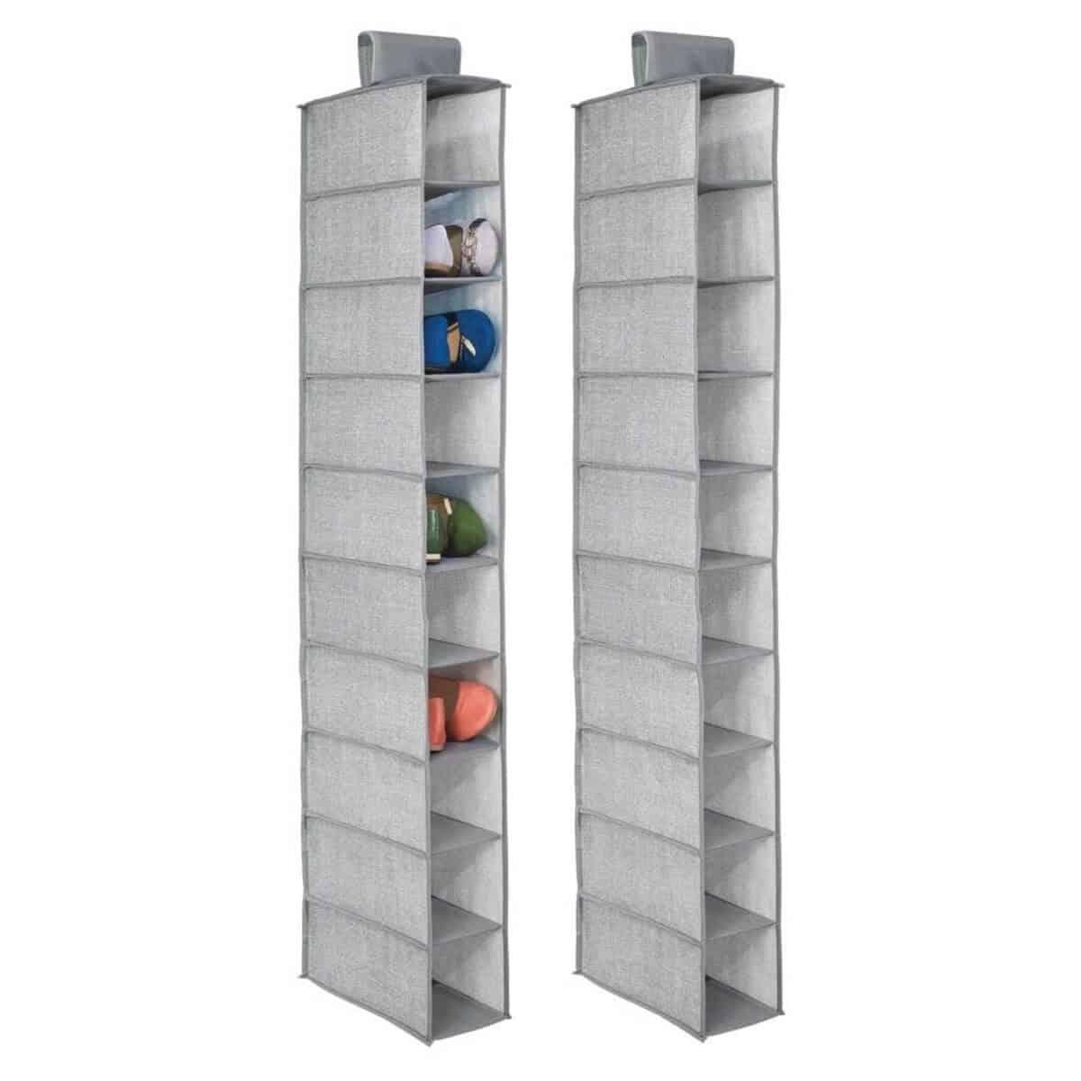 Two grey fabric vertical shoe storage organizers.