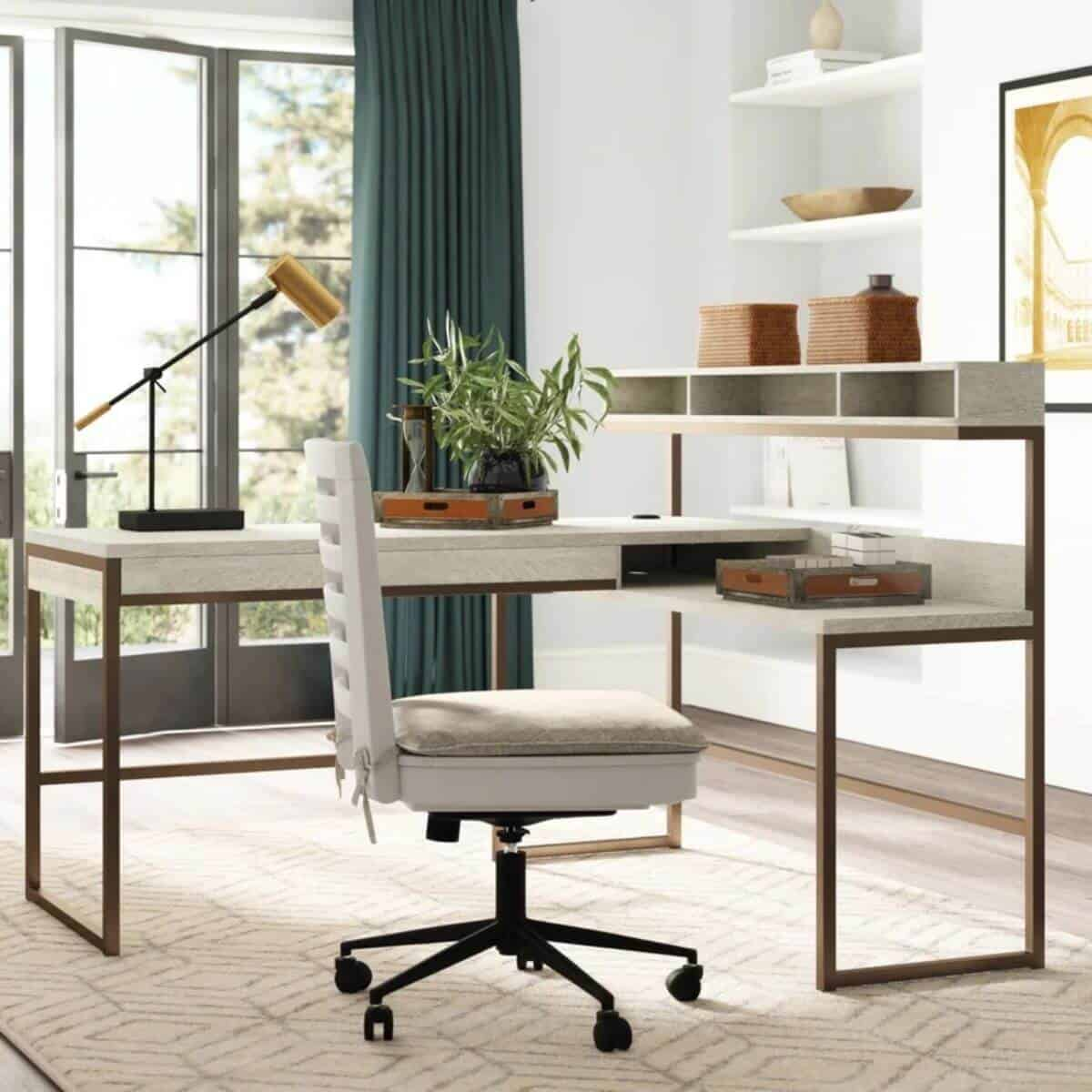 White L-shaped desk with metal frame in a room.