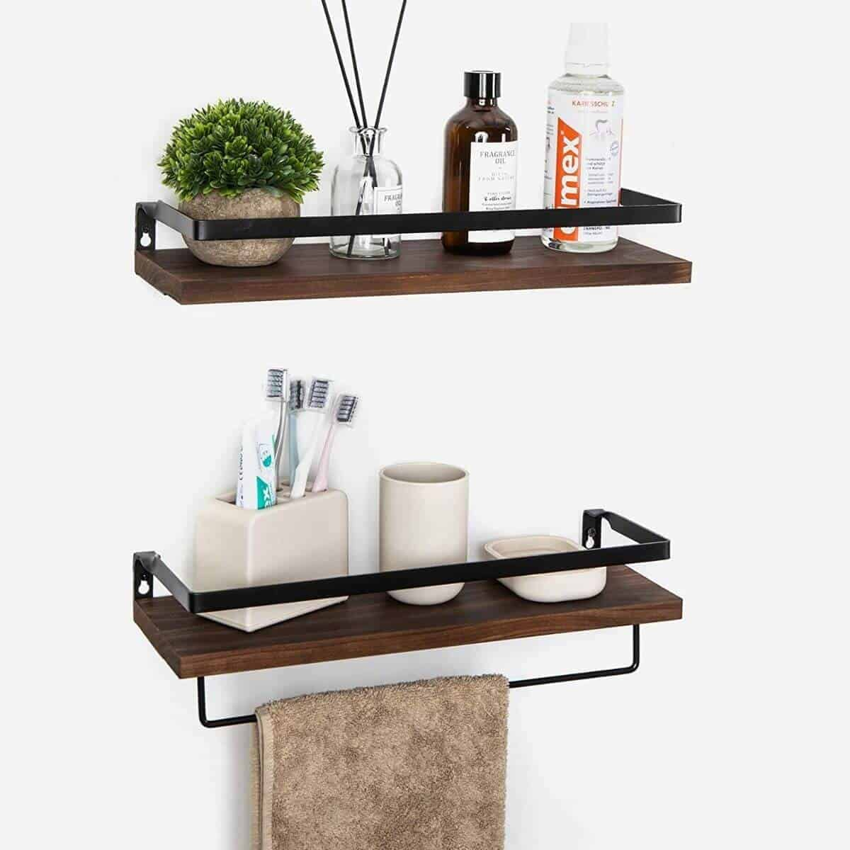 Two wooden floating shelves with bathroom items on it.