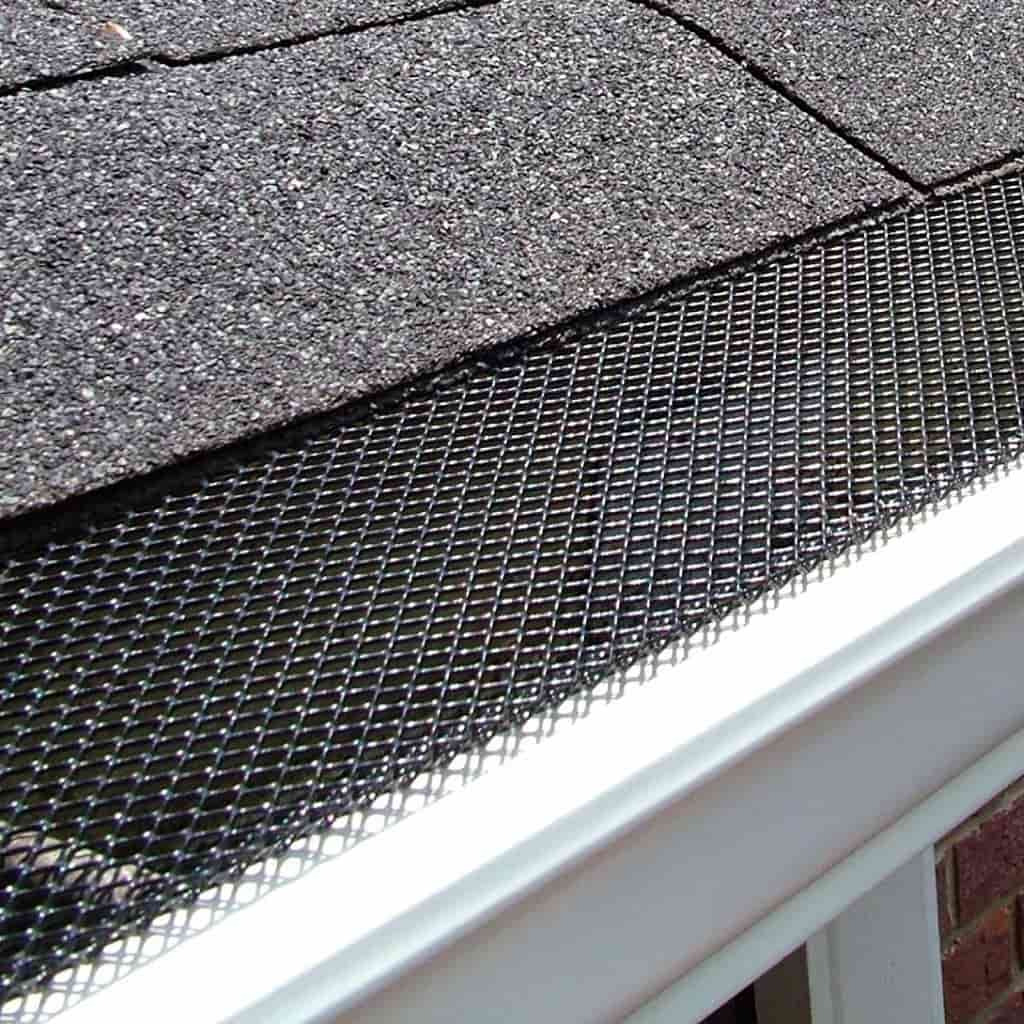 Amerimax black gutter guard installed on a roof.
