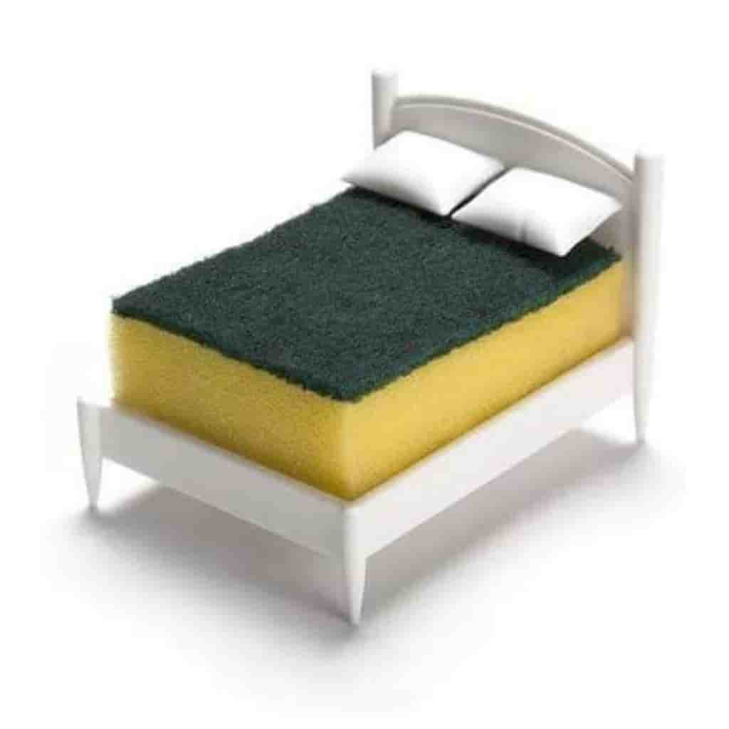 Sponge holder that looks like a bed with pillows.