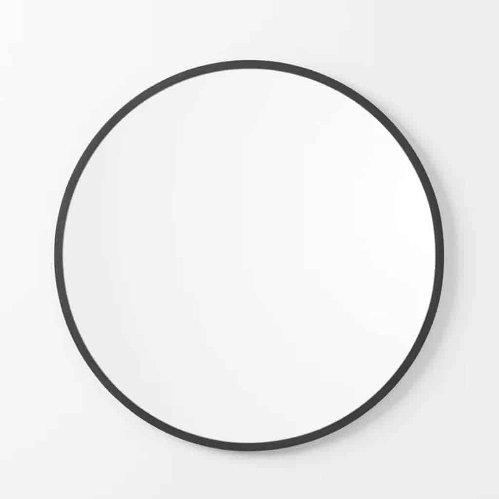 Circular mirror with a black frame.