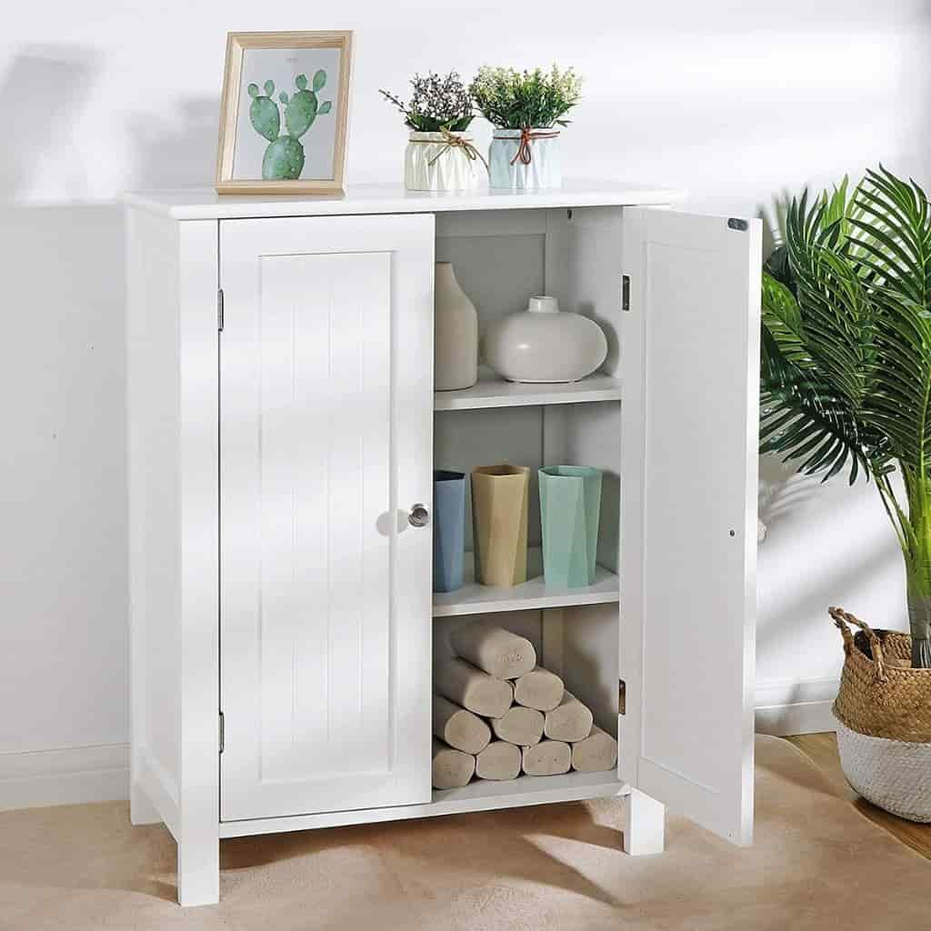White cabinet with plants and a door opened to show what's inside.