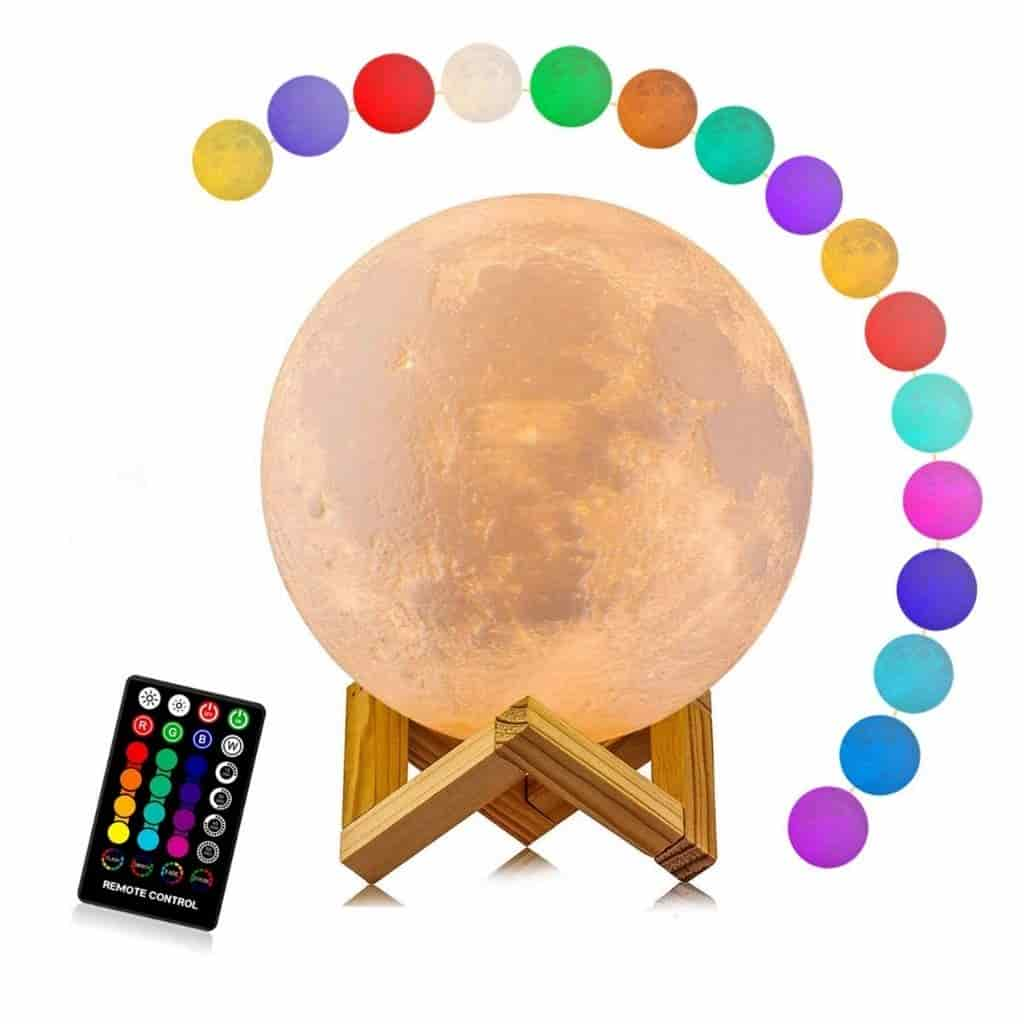 Moon lamp on a stand, the remote control, and all of the variations of color.