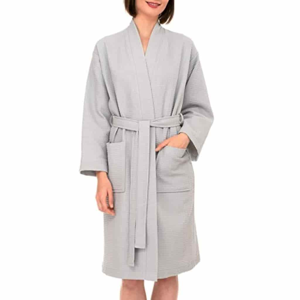 Person wearing a grey waffle robe.