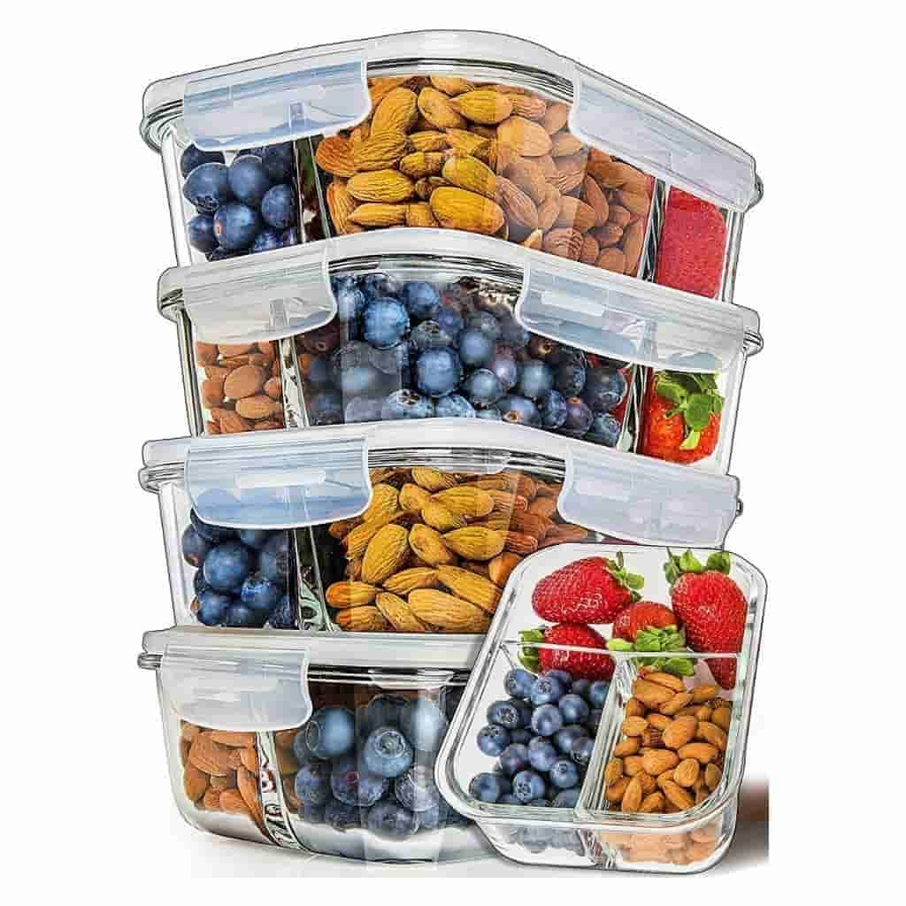 Stack of glass containers with compartments and food.