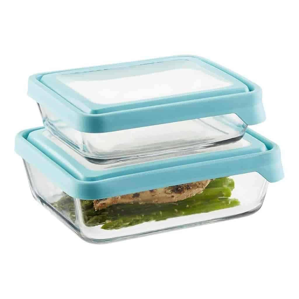 Stack of two glass food containers with blue lids.