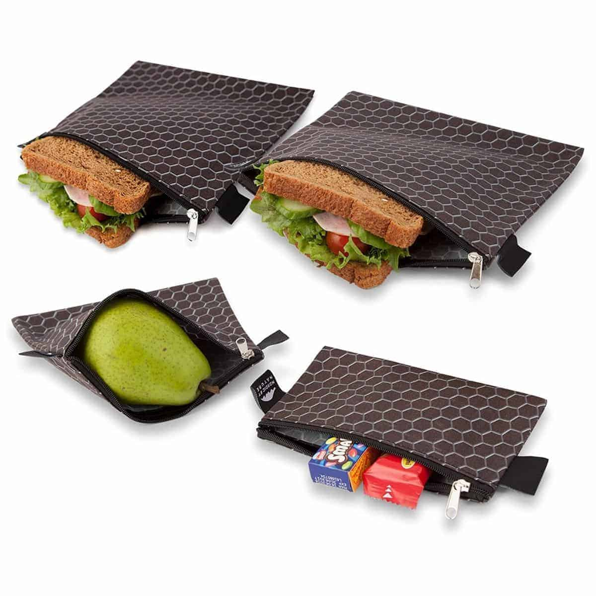 Black fabric reusable sandwich and snack bags with a zipper.