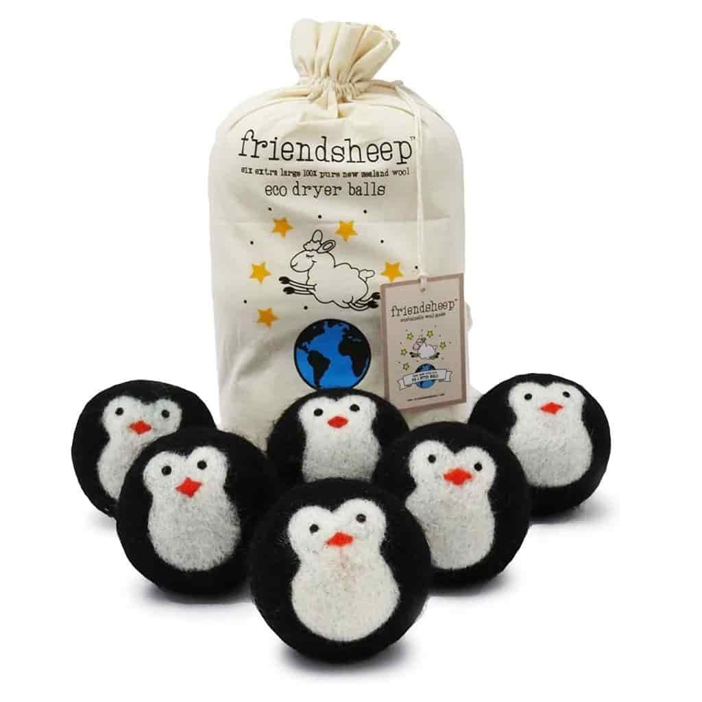 Six penguin dryer balls and a cloth bag.