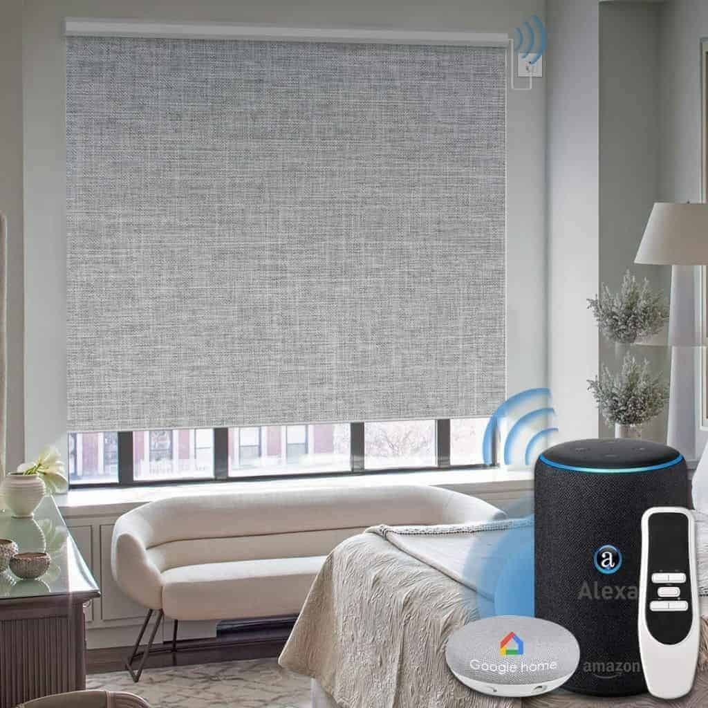 Graywind motorized blackout shades in a bedroom.