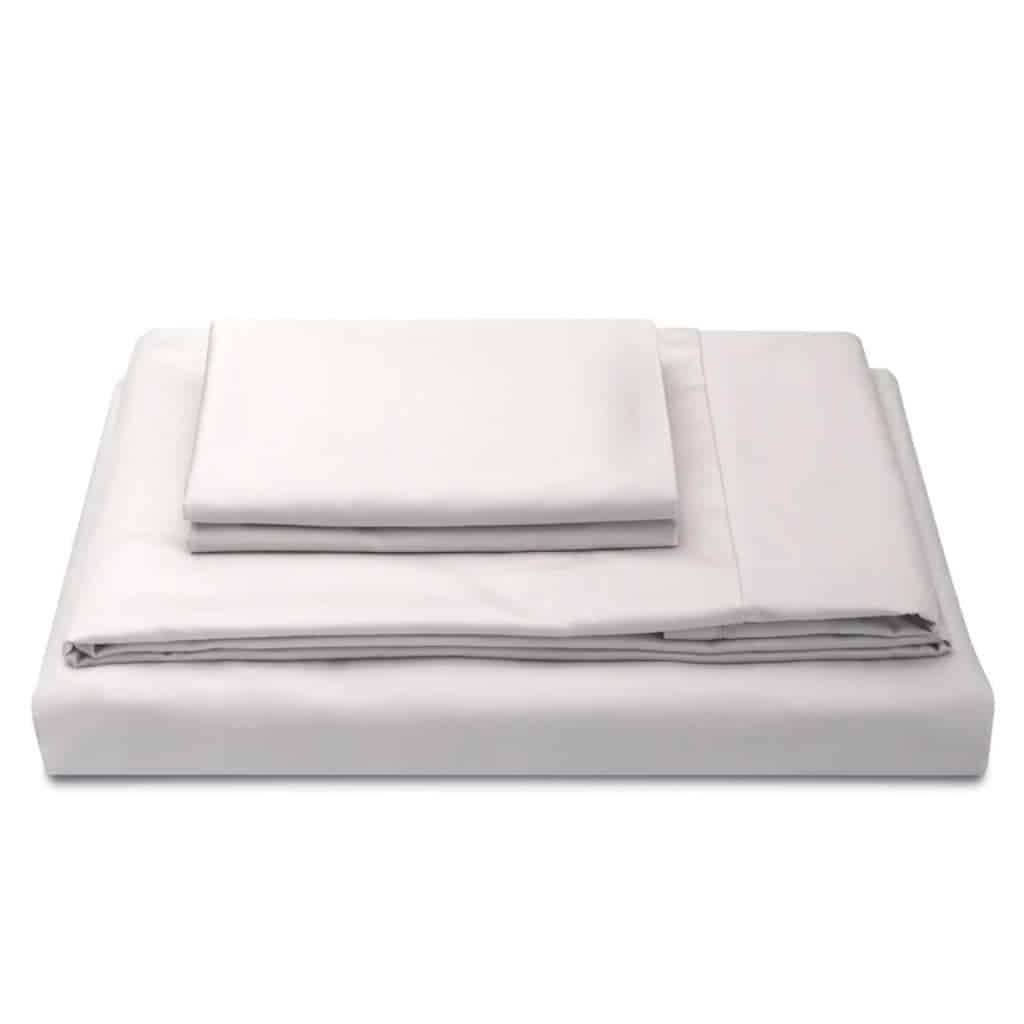 Stack of ivory bed sheets.