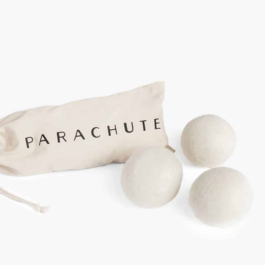 Three Parachute wool dryer balls and the bag.