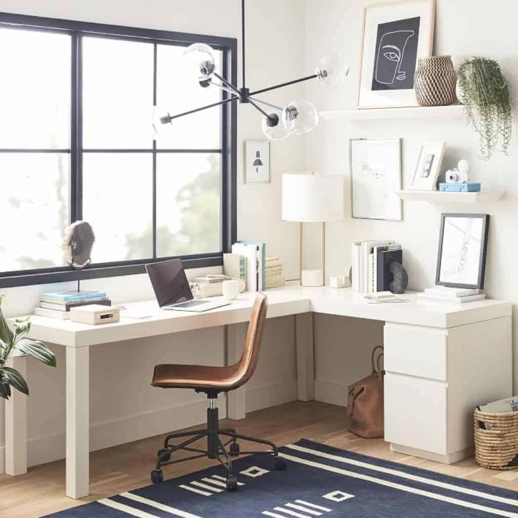 Home office showing a white L-shaped desk.
