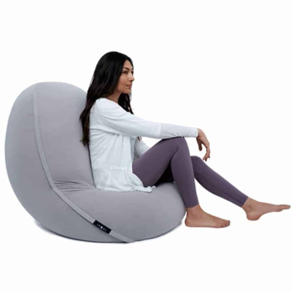 Person sitting in a grey Moon Pod.