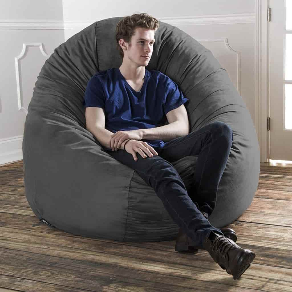 Person sitting on a bean bag.