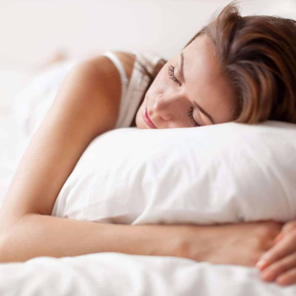 Close-up of a person sleeping on a pillow.