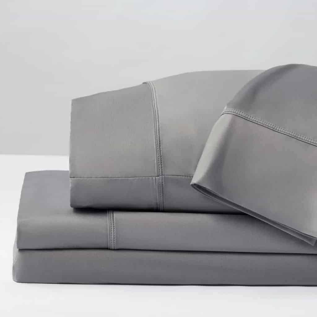 Stack of grey bed sheets by Sheex.