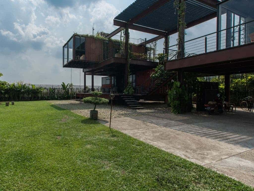 Two-story container home with open area.