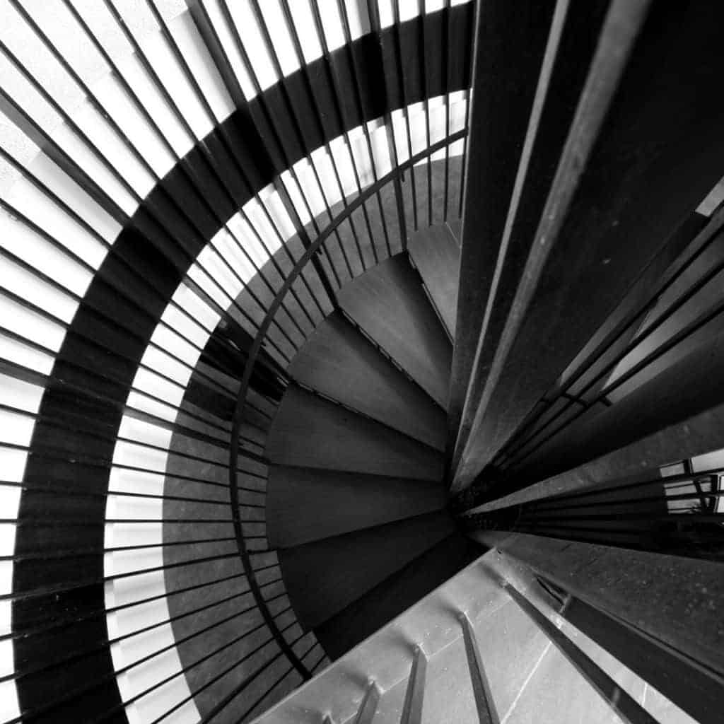 Greyscale of a spiral staircase.
