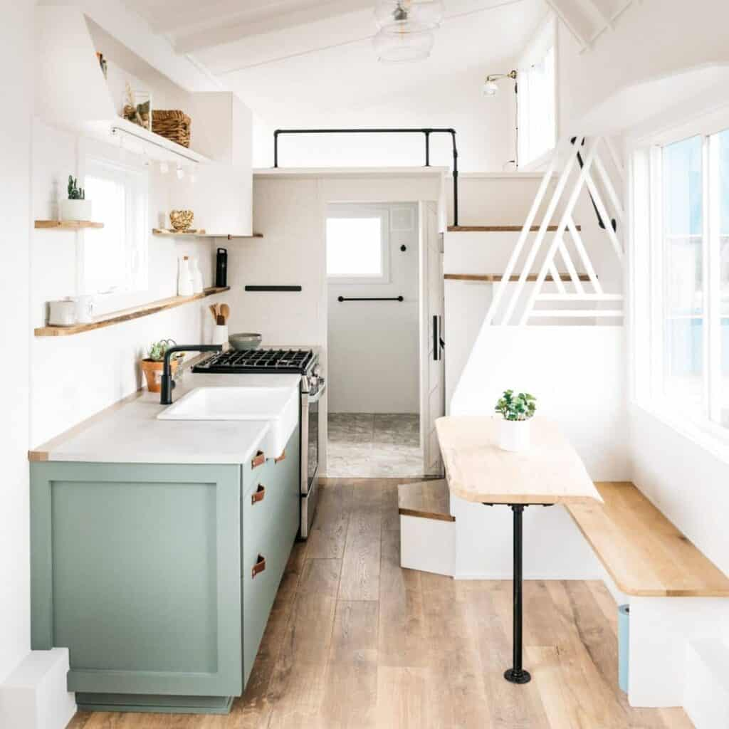 Interior of a tiny house showing the kitchen.