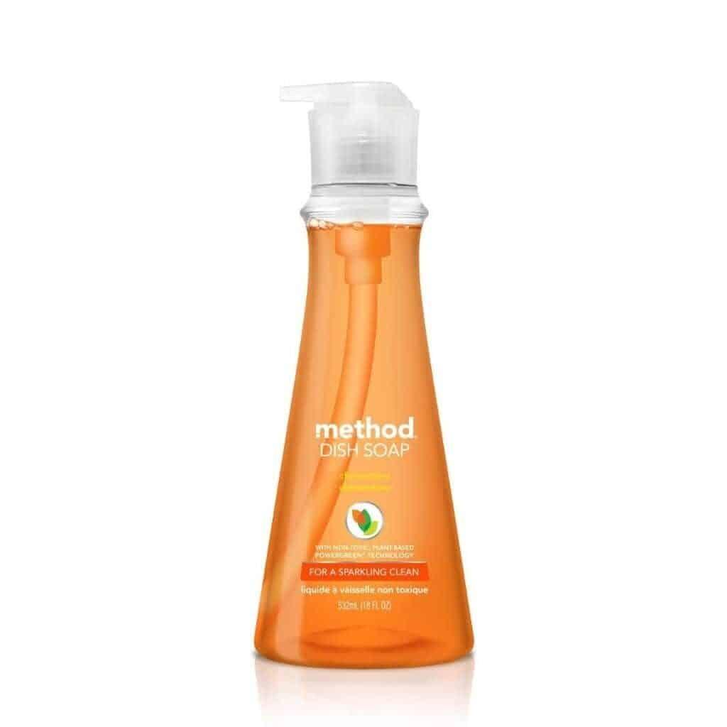 Bottle of orange Method dish soap.