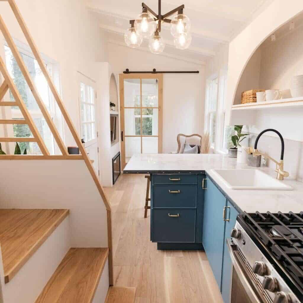 Tiny house interior will an L-shaped kitchen.