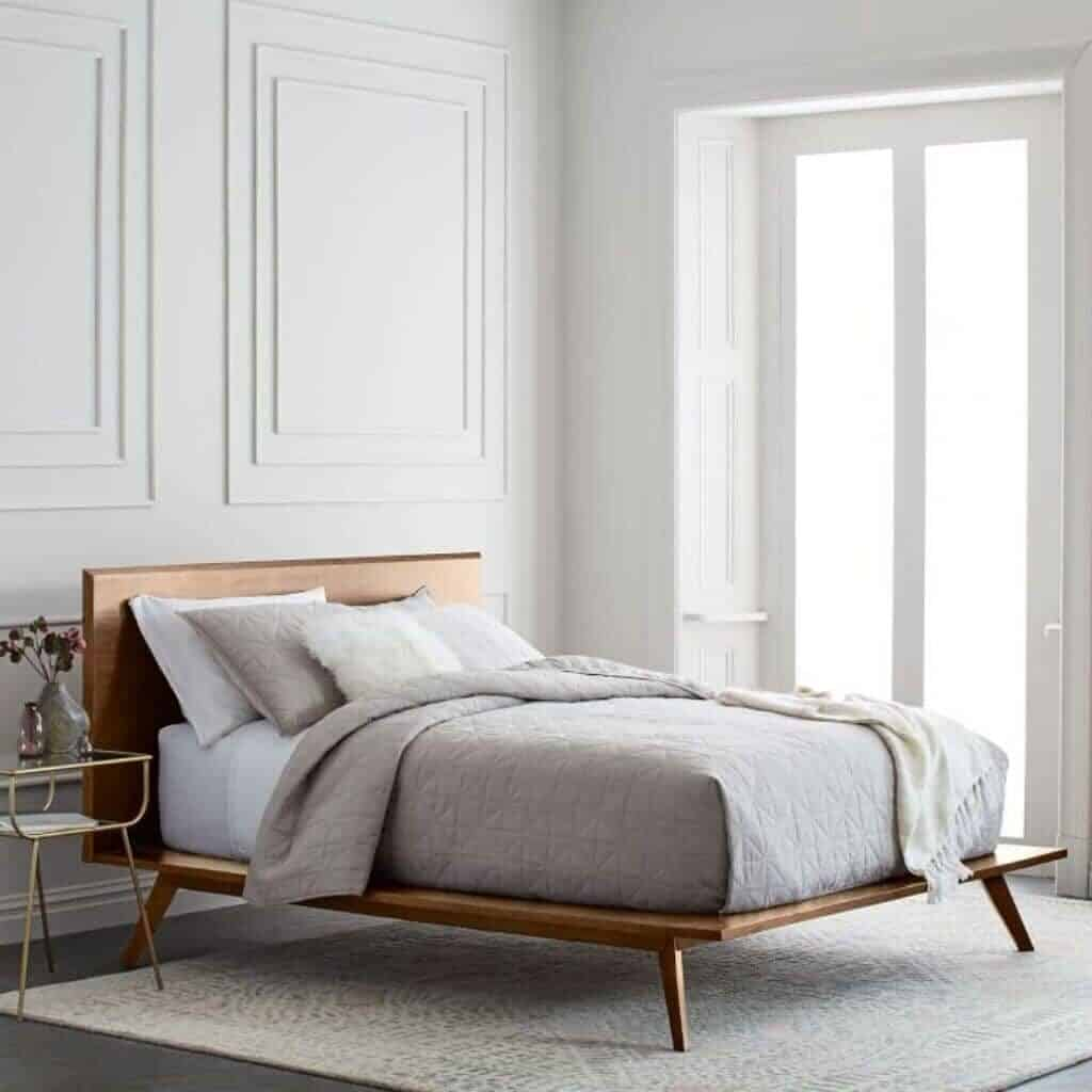 Wooden platform bed in a bedroom.