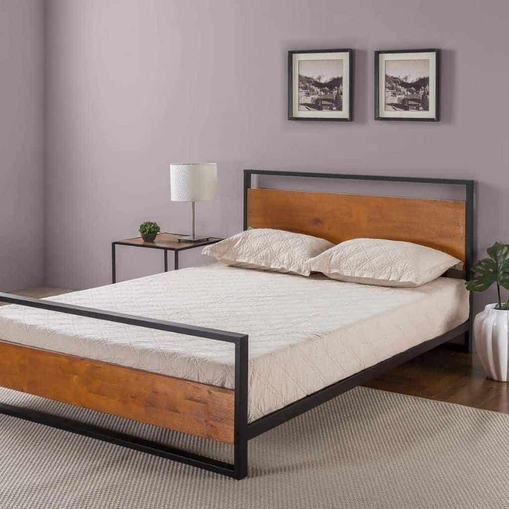 Wood and metal platform bed in a grey room.