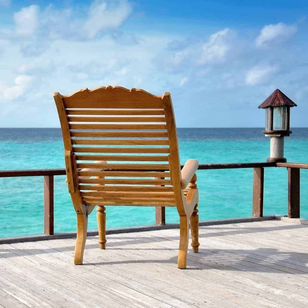 Wooden chair with a view of the ocean.