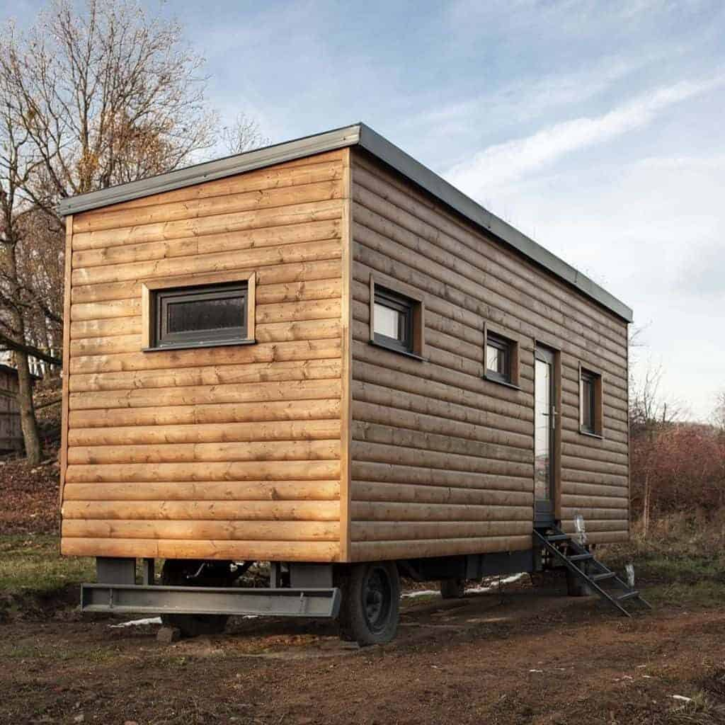 Small wooden house on wheels.