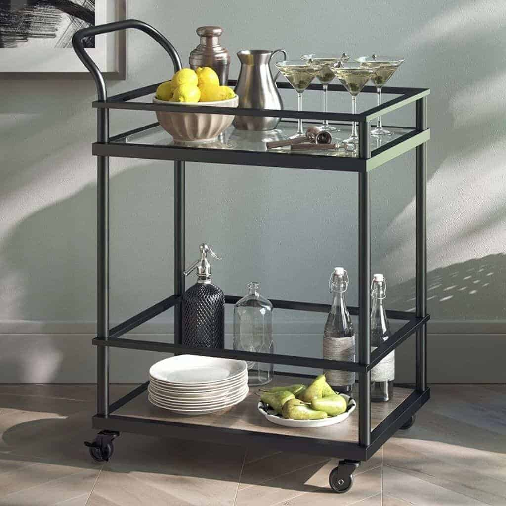 Bar items and food on a black and wood bar cart.